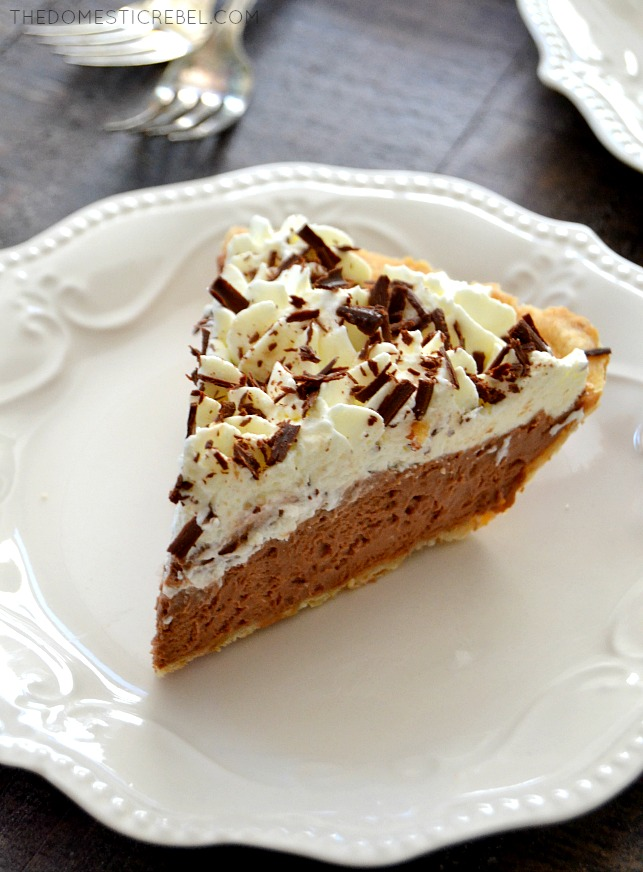 French Silk Pie slice on white plate and wood background with forks