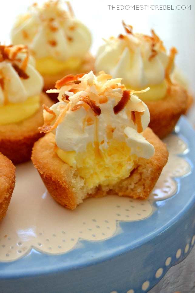 Coconut Cream Pie Cookie Cups with bite missing on blue and white cake stand