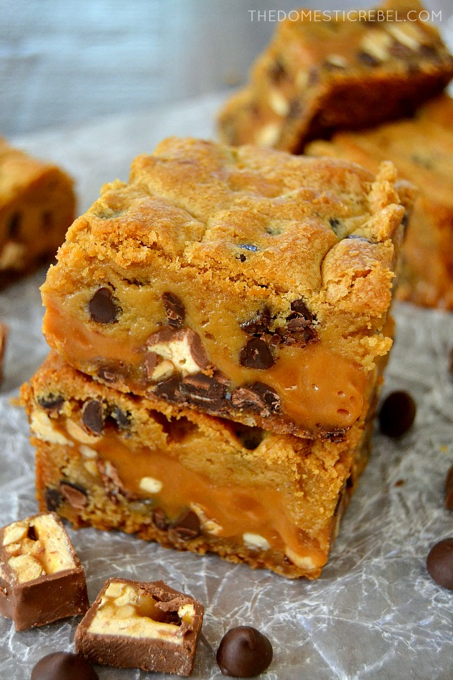 These Thick & Chewy Snickers Cookie Bars have only 6 simple ingredients and are SO EASY to make! Gooey, buttery, chocolaty and packed with flavor, they'll be your new way to eat a Snickers!