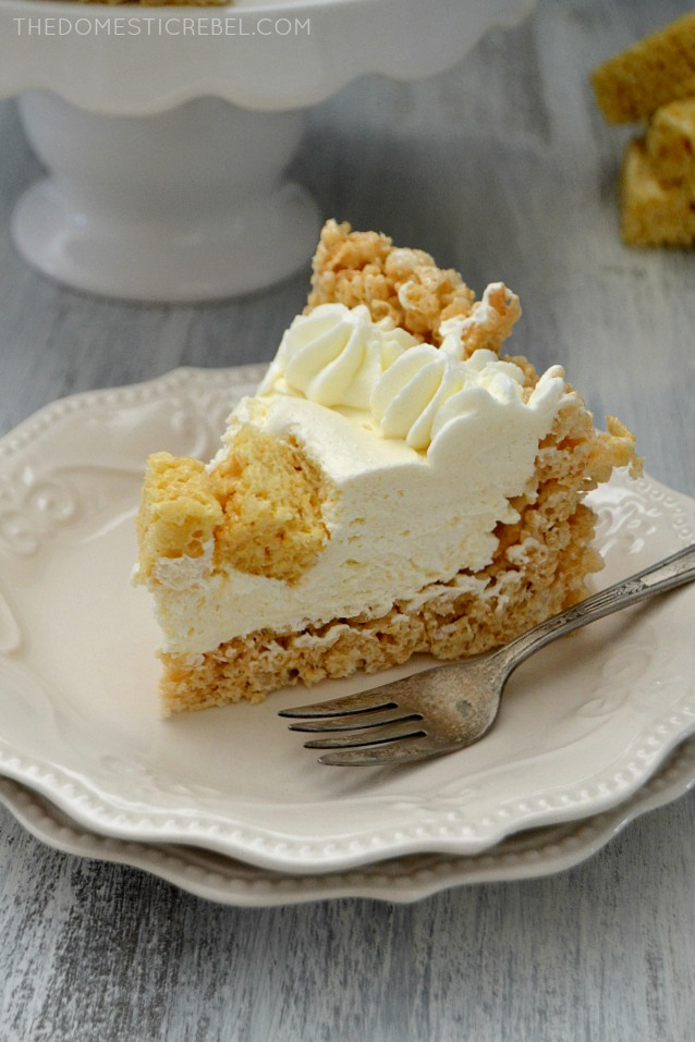 This Rice Krispy Treat No Bake Marshmallow Cheesecake is amazing! A total crowd pleaser, it's super easy to make and no-bake! Gooey, fluffy, creamy and smooth with that wonderful marshmallow flavor!