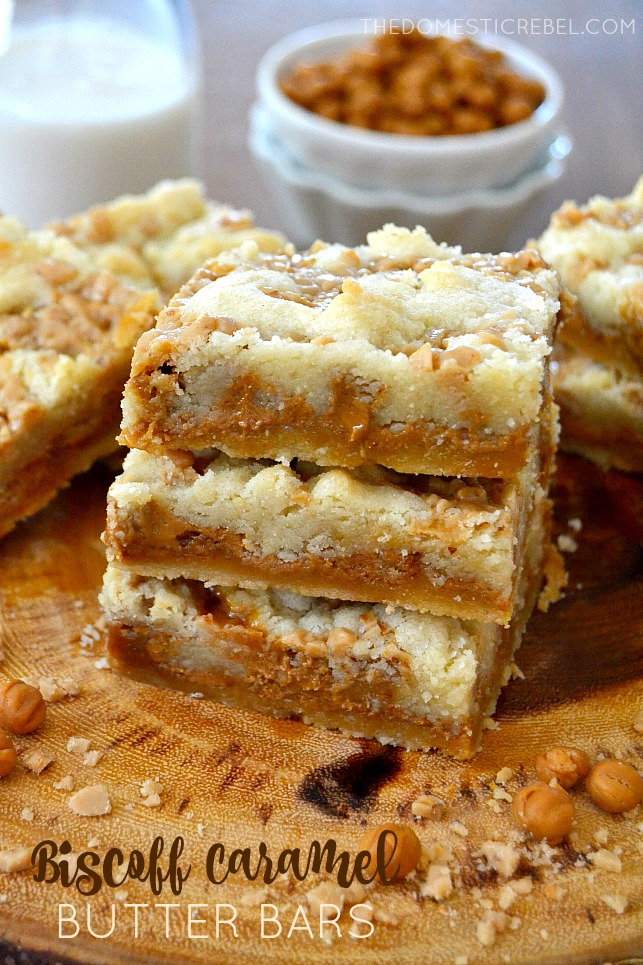 Biscoff Caramel Butter Bars arranged on wood plank with caramel bits