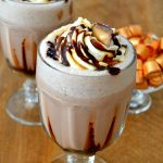 This Caramel Macchiato Frozen Hot Chocolate is so dreamy! Freezy, icy, creamy and perfect, it's made in minutes and has wonderful buttery caramel and rich chocolaty flavors!