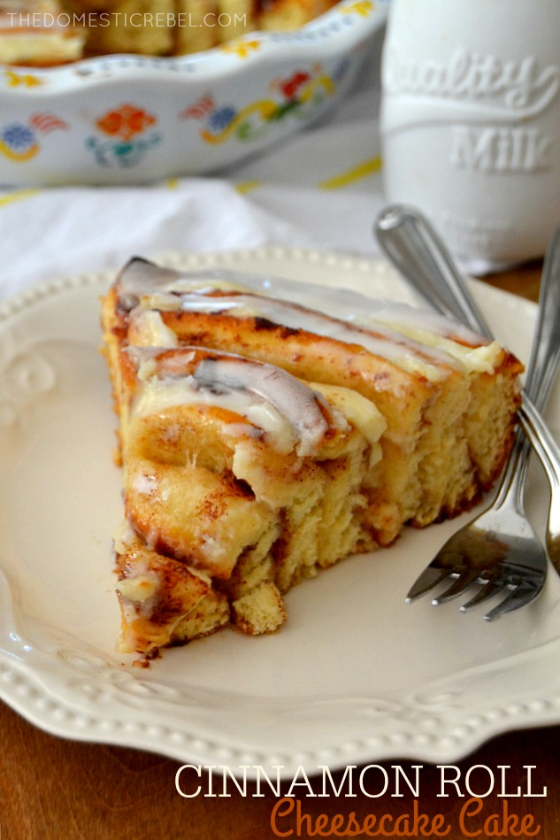 Cinnamon Roll Cheesecake Cake on white plate with forks and milk in background