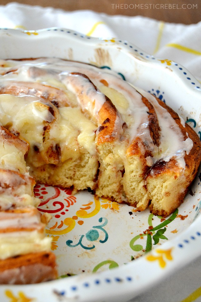 Cinnamon Roll Cheesecake Cake in pie dish on white fabric