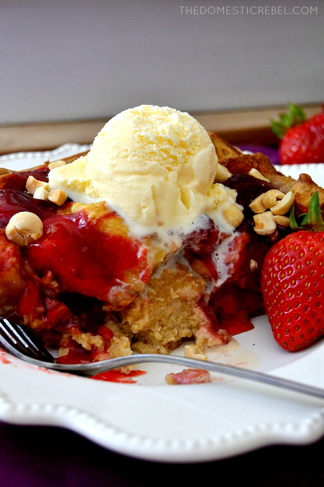 PBJ Bread Pudding on white plate with fork and strawberry