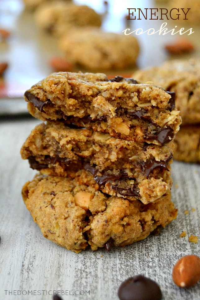 Energy Cookies stacked on wood with almonds and choc chips