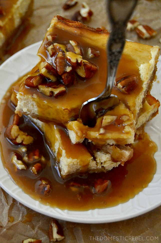 closeup stack of pecan praline cheesecake bars on plate with fork