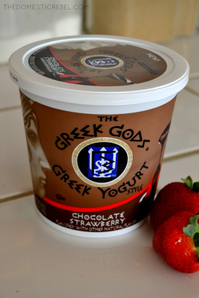 photo of greek gods chocolate yogurt in container with strawberries