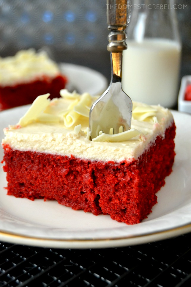 red velvet cake slice on white plate with fork in it