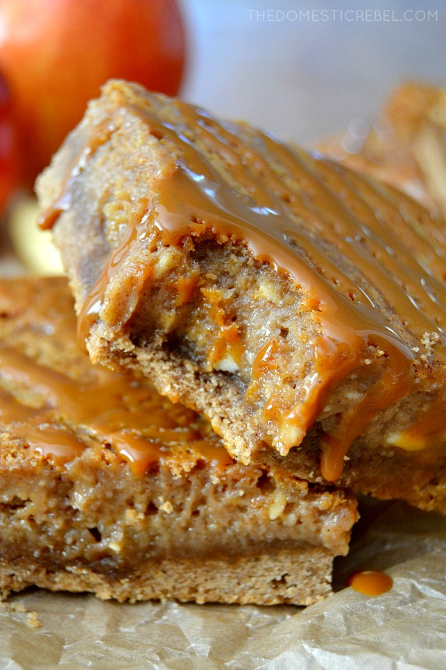 These Caramel Apple Butter Gooey Bars are so delicious and GREAT for fall! A spice cake base, cinnamon & apple pie-spiced apple butter filling and buttery caramel complete these gooey, chewy, perfect bars.