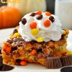 Peanut Butter Cup Pumpkin Pie Cake: a delightful mash-up between creamy pumpkin pie and fluffy cake that's studded with rich and gooey peanut butter cups and Reese's Pieces candies! A wonderful fall-favorite that's so easy to prepare!