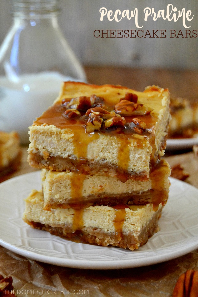 pecan praline cheesecake bars stacked on white plate with milk glass in background