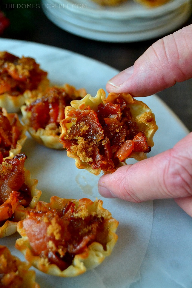 fingers holding maple bacon crack bite
