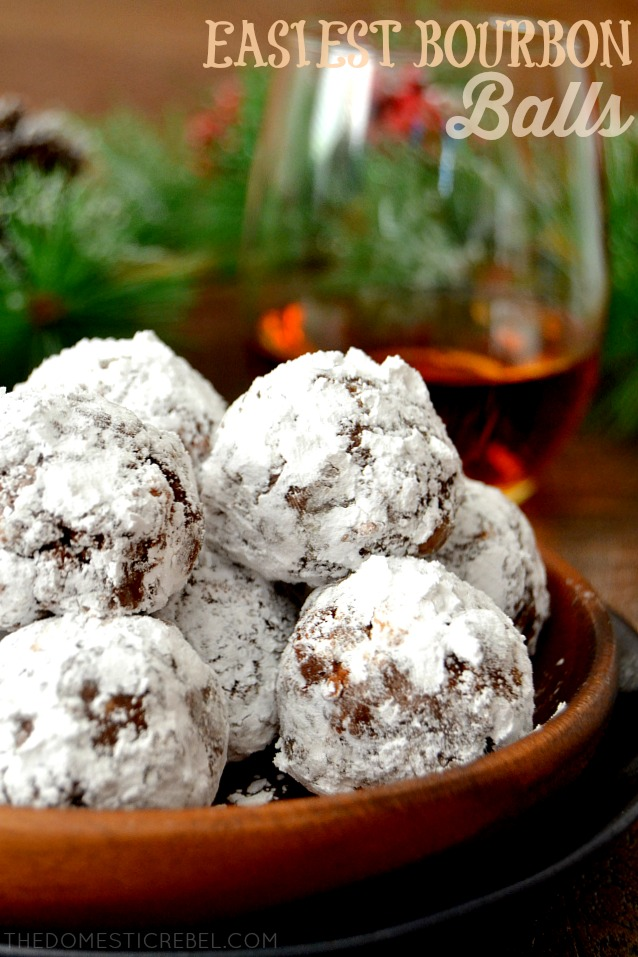 bourbon balls in wood plate with bourbon in background
