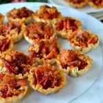 Maple Caramel Bacon Crack Bites: bite-sized morsels of heaven filled with crispy, smoky bacon, sweet brown sugar and sticky, syrupy maple syrup. Only four easy ingredients and it makes a TON. Easily doubled or tripled! A must-make!