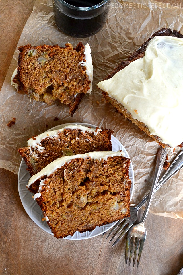 gingerbread banana bread arranged on parchment and wood with coffee and forks