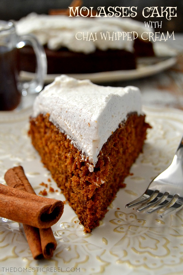 molasses cake slice on a white plate with fork and cinnamon sticks