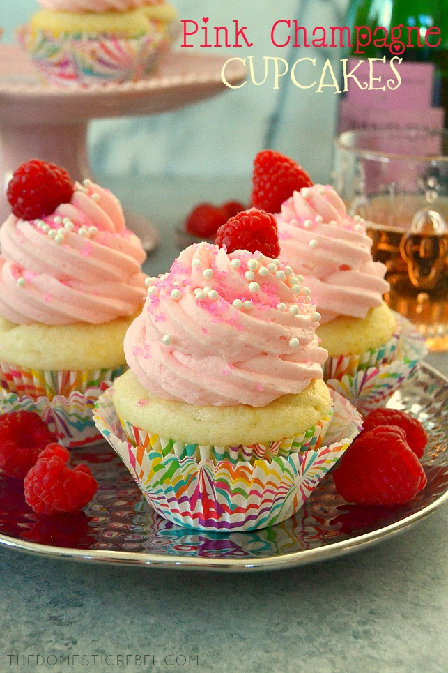 pink champagne cupcakes on silver plate with raspberries