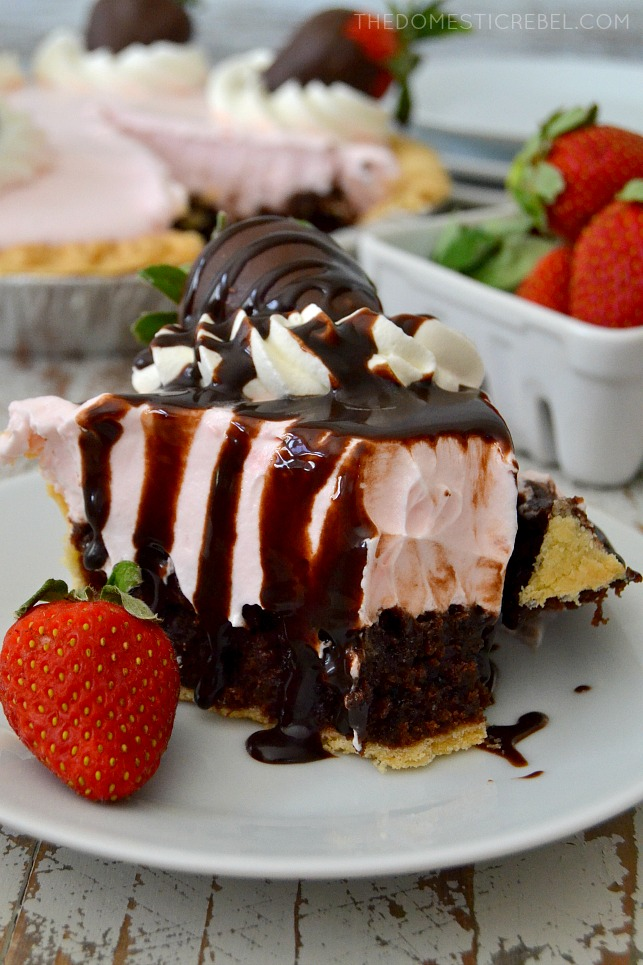 "This Chocolate Covered Strawberry Brownie Pie is a simple and stunning dessert! A fudgy brownie ""crust"" topped with a light & fluffy strawberry pudding mousse and topped with chocolate-covered berries. Have your fruit and cover it in chocolate, too!"
