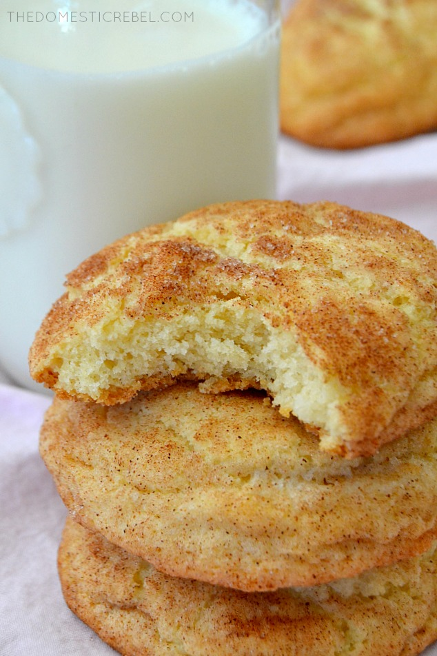3 snickerdoodles stacked, one with a bite taken out of it.
