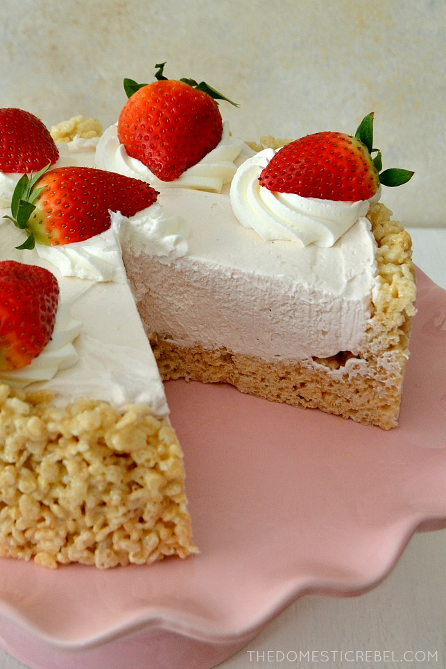 This RICE KRISPY TREAT NO-BAKE STRAWBERRY CHEESECAKE is such a show-stopping dessert! No-bake, so easy to whip up, quick and impressive, it features a gooey Rice Krispy Treat crust, a smooth & creamy strawberry cheesecake filling and is topped with fresh strawberries.