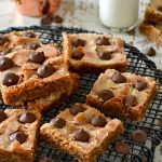 These Peanut Butter Blossom Blondies are fantastic! Fudgy, peanut buttery, brown sugar blondies topped with a crackly, crisp sugar topping and rich, melt in your mouth Hershey Kisses. Just like the cookies but so much easier!