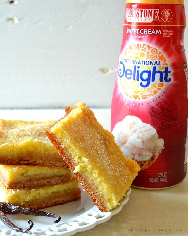 FOUR GOOEY BARS STACKED NEXT TO INTERNATIONAL DELIGHT'S SWEET CREAM COFFEE CREAMER