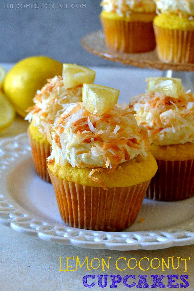 THREE LEMON COCONUT CUPCAKES ON A WHITE DISH.