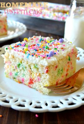 This Homemade Funfetti Cake from scratch is so delicious! Moist, soft, fluffy with a tender crumb, this homemade vanilla cake is studded with sprinkles and topped with a creamy buttercream frosting! Great for feeding a crowd or just because!