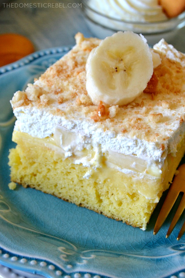 BANANA PUDDING POKE CAKE WITH A BANANA SLICE ON TOP