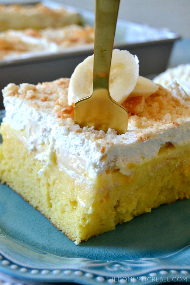 SLICE OF BANANA PUDDING POKE CAKE WITH A FORK