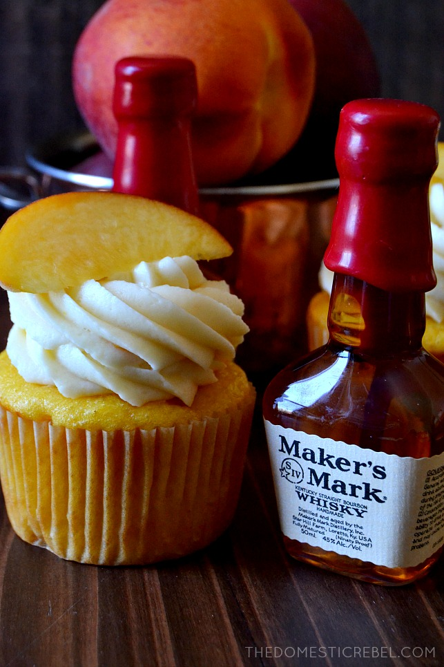 ONE CUPCAKE NEXT TO A BOTTLE OF MAKER'S MARK WHISKY