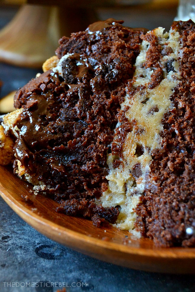 "This Slutty Brownie Cookie Dough Cake takes the Pinterest favorite to a whole new level! Two fudge brownie ""cake"" layers sandwiched around egg-free chocolate chip Oreo cookie dough, topped with smooth chocolate ganache and bite-size morsels of brownies, chocolate chip cookies, and Oreos! So decadent, impressive, and OUTRAGEOUS!"