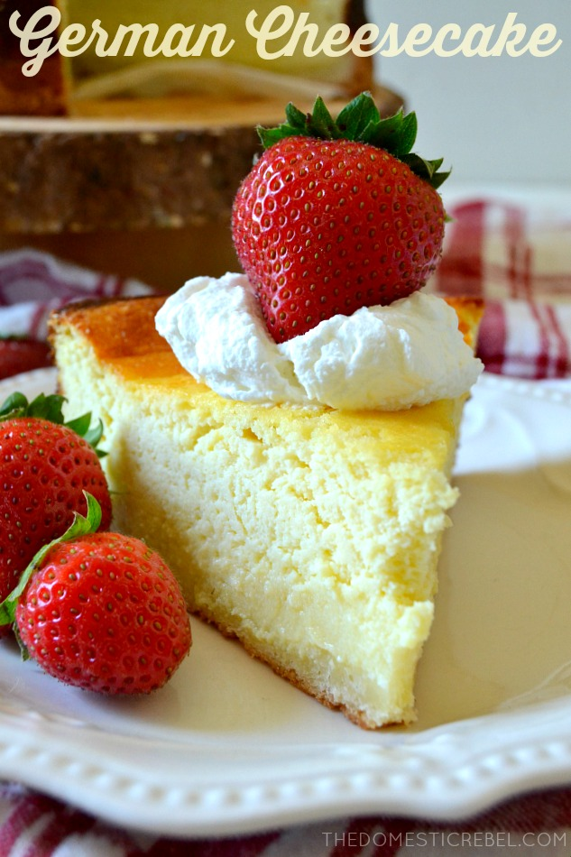 german cheesecake slice on white plate with strawberries