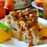 This Peach Pecan Crumb Cake with Bourbon Caramel is such a show-stopping dessert! A moist, fluffy vanilla cake studded with fresh, juicy peaches and topped with a sky-high pecan and brown sugar streusel! But the homemade bourbon caramel sauce sends it OVER the top!