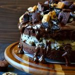"""This Slutty Brownie Cookie Dough Cake takes the Pinterest favorite to a whole new level! Two fudge brownie """"cake"""" layers sandwiched around egg-free chocolate chip Oreo cookie dough, topped with smooth chocolate ganache and bite-size morsels of brownies, chocolate chip cookies, and Oreos! So decadent, impressive, and OUTRAGEOUS!"""