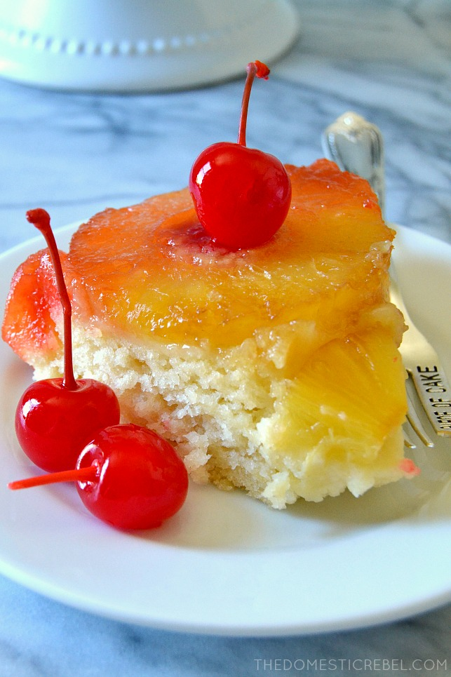 SLICE OF PINEAPPLE UPSIDE DOWN CAKE ON A PLATE WITH THREE CHERRIES
