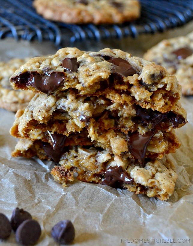 FOUR HALVES OF OATMEAL CHOCOLATE CHIP COOKIES STACKED