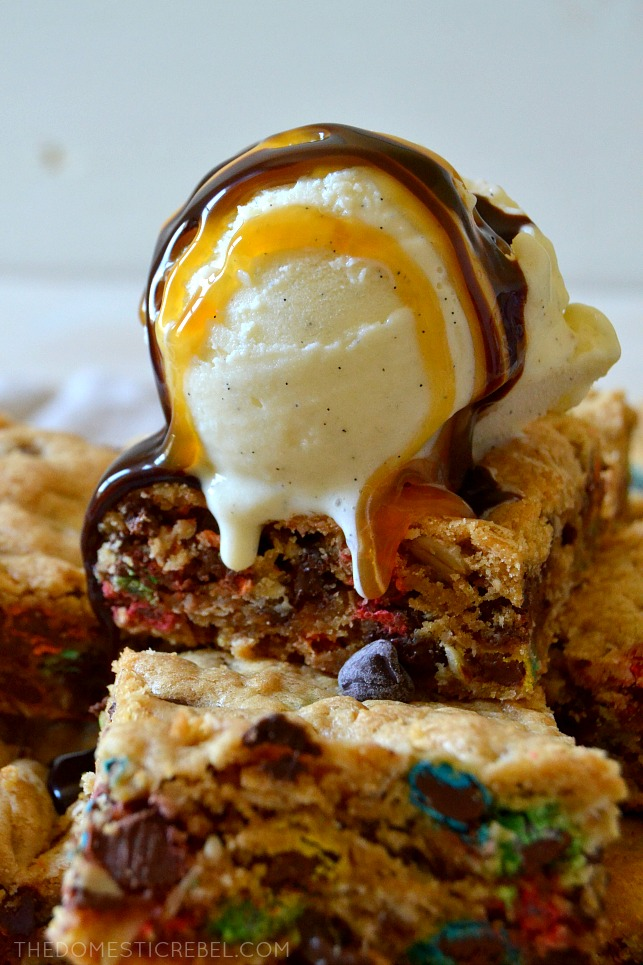 These Thick & Chewy Monster Cookie Bars taste just like your favorite monster cookie recipe but EASIER! Loaded with chewy oats, creamy peanut butter, gooey chocolate chips and crunchy mini M&M's, they're flavorful, thick, super chewy, and DELICIOUS!