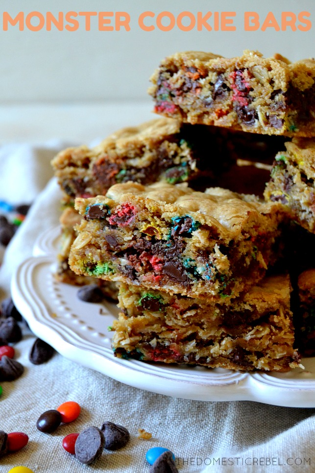 monster cookie bars piled up on a white dish