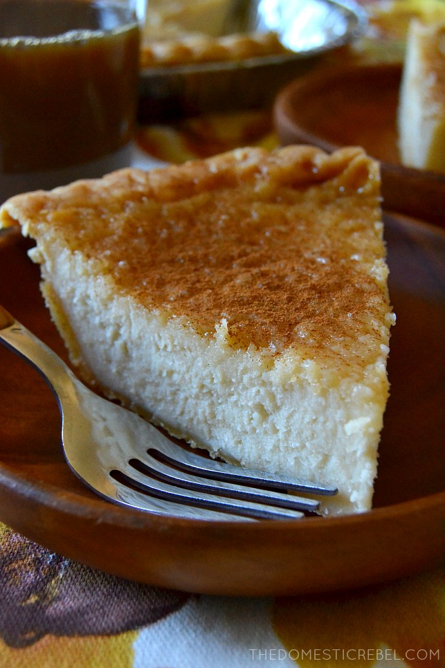 side view of a slice of maple cream pie on a brown dish