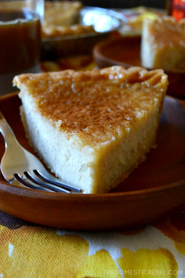 slice of maple cream pie on a brown dish next to a fork