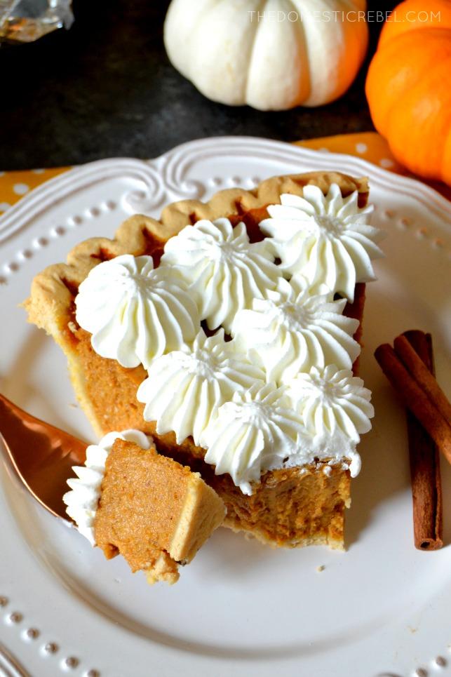 slice of pumpkin pie missing a bite