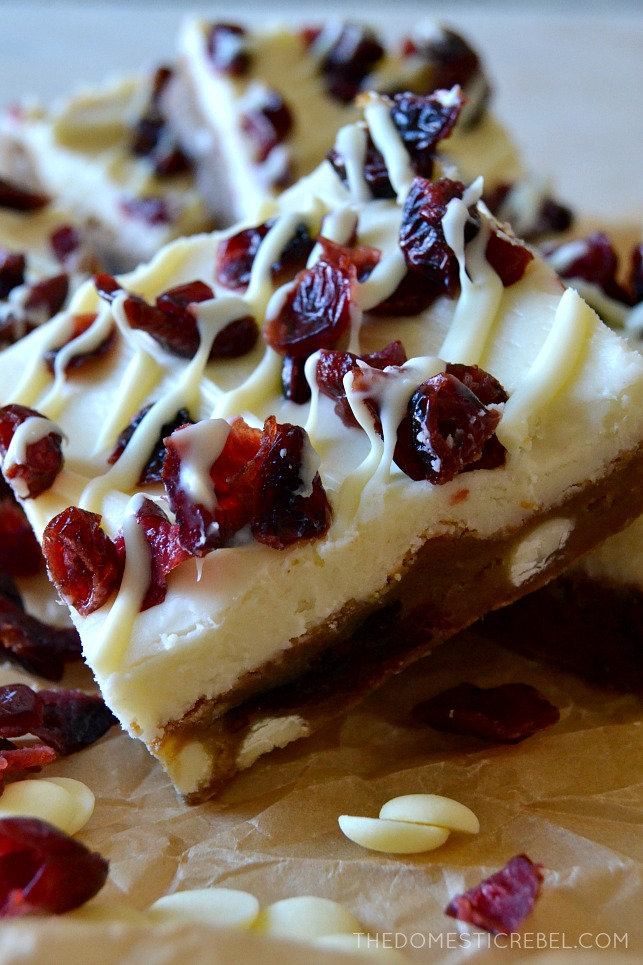 These are the PERFECT Copycat Cranberry Bliss Bars - the best I've tried! Fudge-like, chewy brown sugar blondies stuffed with cranberries and white chocolate, topped with a fluffy white chocolate cream cheese frosting, tart cranberries, and a drizzle of white chocolate. Heaven for the holidays, and great for Christmas cookie trays!