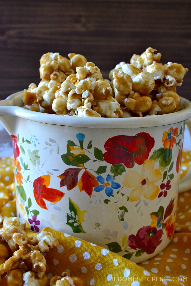 caramel popcorn in a floral fish and on a yellow polka dot towel