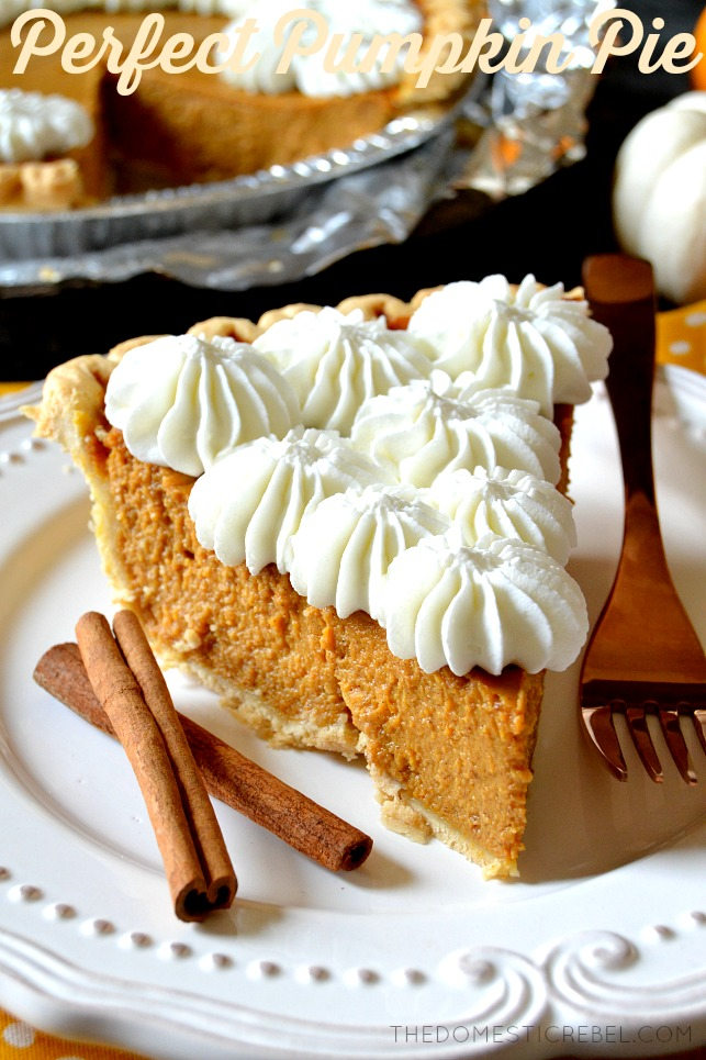 pumpkin pie slice on white plate with cinnamon sticks and fork