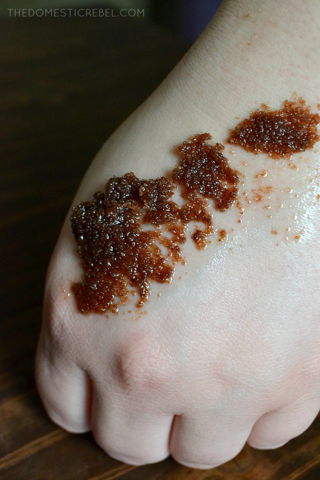 chocolate sugar scrub spread on person's hand