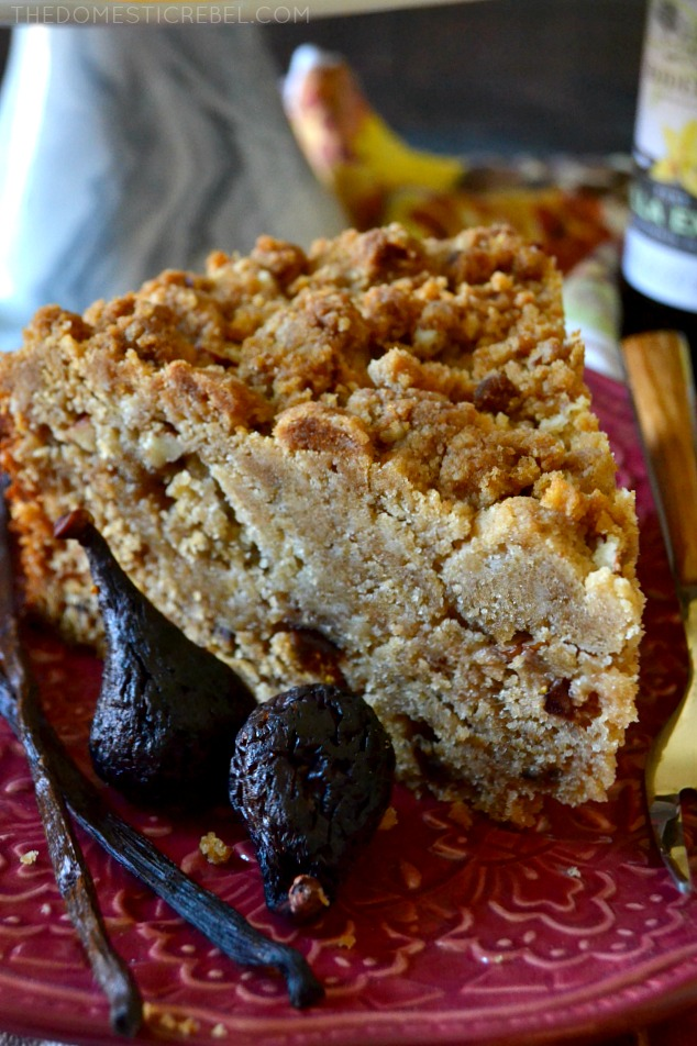 slice of crumb cake on a red plate with figs