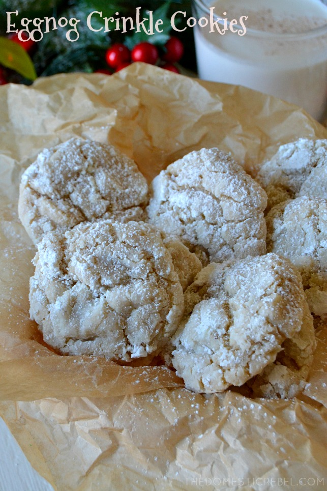multiple eggnog crinkle cookies arranged on parchment paper