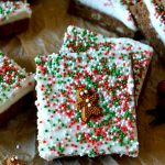 These Gingerbread Blondies with Cream Cheese Frosting are perfect for the holidays! Soft, chewy, perfectly spiced blondies are topped with a smooth and fluffy cream cheese icing and are decorated adorably for the holidays! Easy and feeds a crowd!